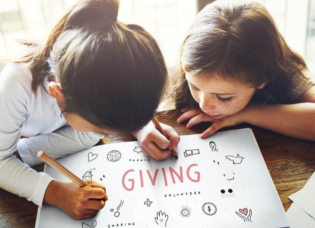 Children writing a Giving sign